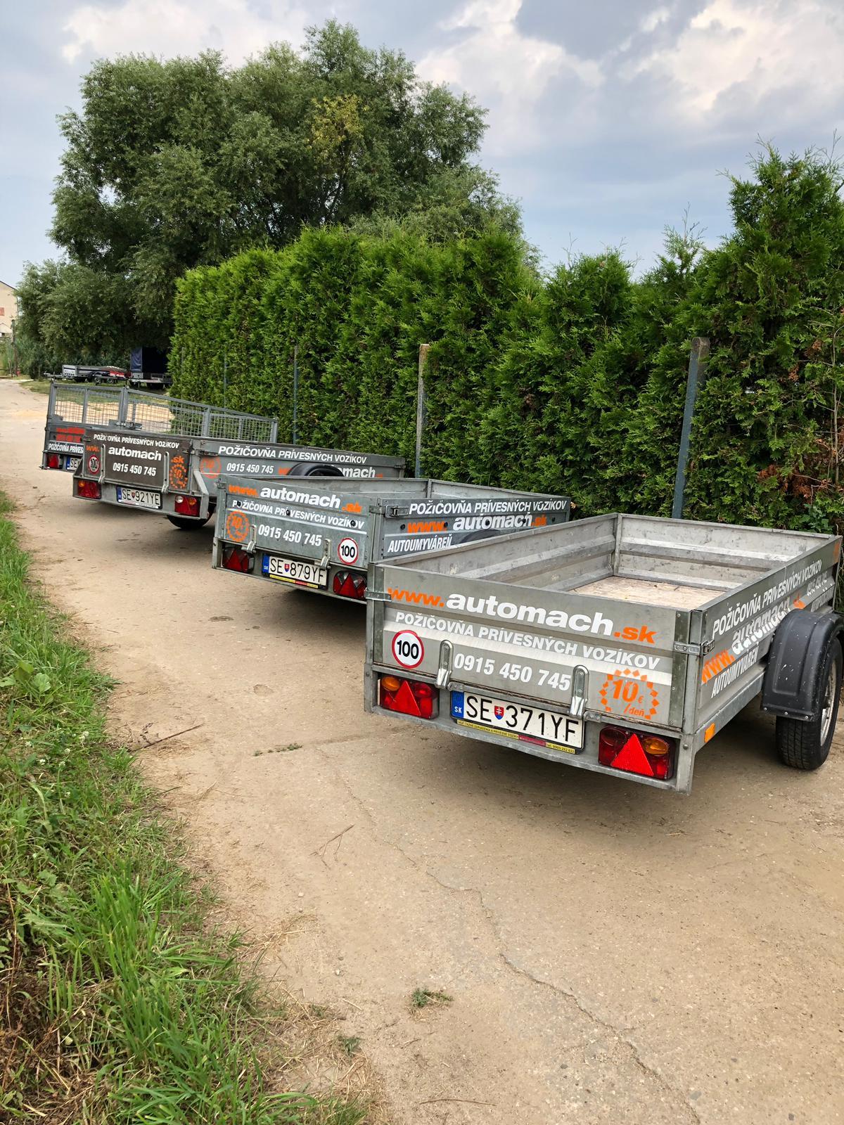Prívesné vozíky sklopné aj pevné na prepravu sypkých príp.iných materiálov